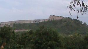 hampir separo bukit hilang, karena penambangan